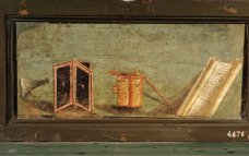 Still-life with writing materials (tablet and scroll, scraper, inkpot, reed pen), from Pompeii. 1st c. CE. Inv. 4676.